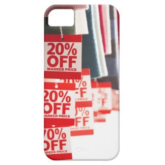 Sale tags attached to hanging clothes, close-up iPhone 5 cover