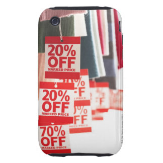 Sale tags attached to hanging clothes, close-up tough iPhone 3 case