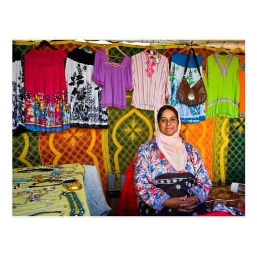 Saleswoman at a market postcard