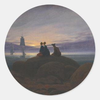 Salida de la luna sobre el mar pegatina redonda