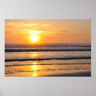 Salida del sol anaranjada Wilbur de la playa por e