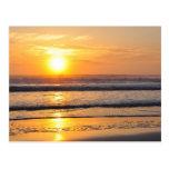 Salida del sol anaranjada Wilbur de la playa por l