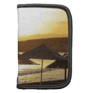 Salida del sol con la playa de Grecia Organizadores