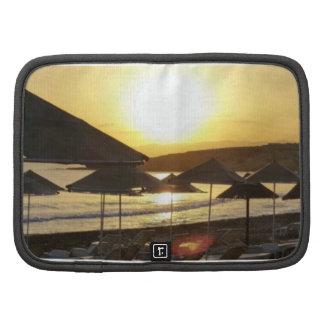 Salida del sol con la playa de Grecia Organizador