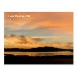 Salida del sol de Casitas del lago Postal