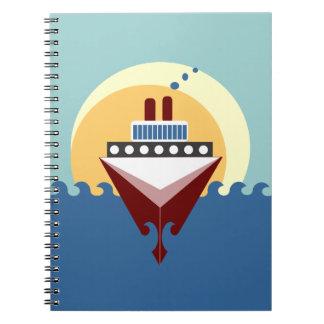Salida del sol del barco de cruceros en el cuadern
