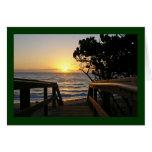 Salida del sol en el paseo marítimo felicitacion