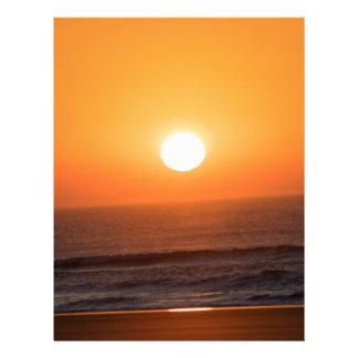 Salida del sol en la costa atlántica membrete