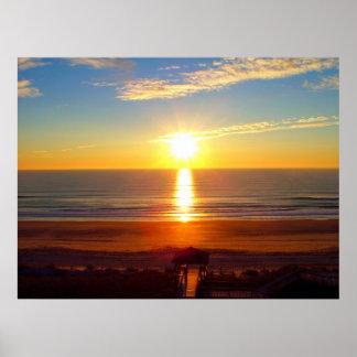 Salida del sol en la playa de Wrightsville Posters