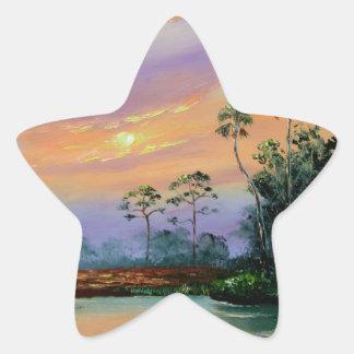 Salida del sol en los marismas pegatina en forma de estrella