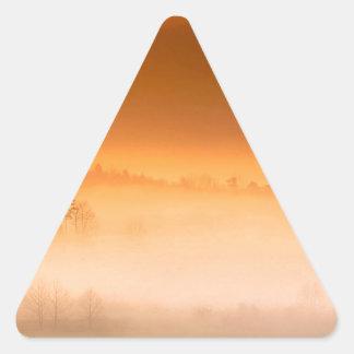 Salida del sol gran Tenne ahumado de la ensenada Pegatina Triangular