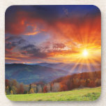 Salida del sol majestuosa en el paisaje de las mon posavasos