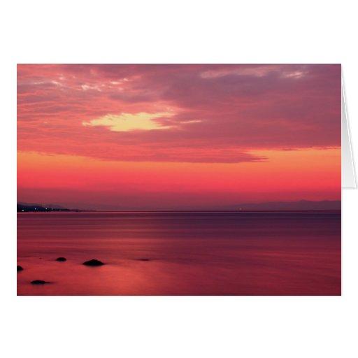 Salida del sol rosada por la playa felicitaciones