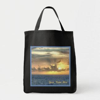 Salida del sol serena sobre el océano bolsa tela para la compra