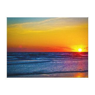 Salida del sol sobre la reflexión III de Océano At Impresiones En Lona Estiradas