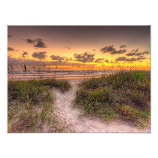 Salida del sol sobre las dunas de arena en Daytona Fotografías