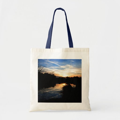 Salida del sol sobre un río bolsa lienzo