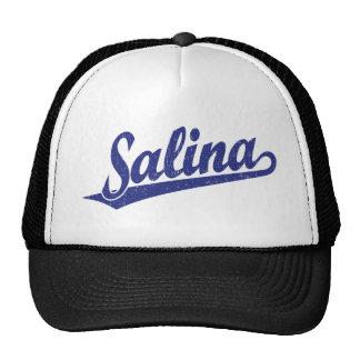 Salina script logo in blue distressed trucker hat