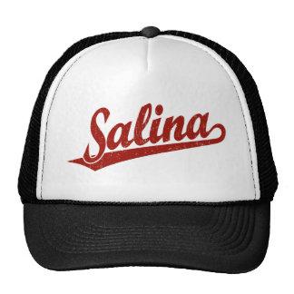 Salina script logo in red distressed trucker hat