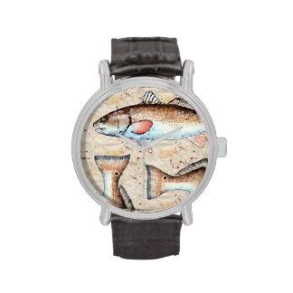 Salmones y colas relojes
