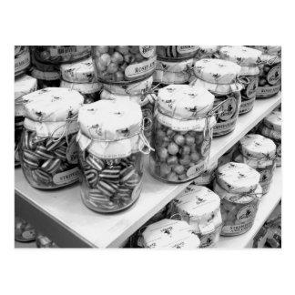 Salmueras y dulces en postal de los tarros
