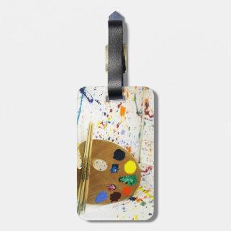 Salpicadura de la pintura de los artistas y etiquetas bolsas