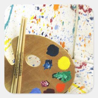 Salpicadura de la pintura de los artistas y pegatina cuadrada