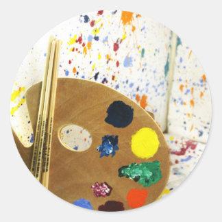 Salpicadura de la pintura de los artistas y pegatina redonda