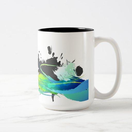 Salpicaduras abstractas de la pintura de aguas fre taza de café