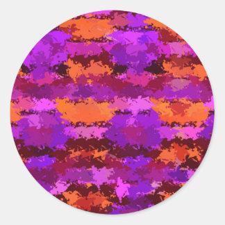 Salpicaduras de la púrpura y del naranja pegatina redonda