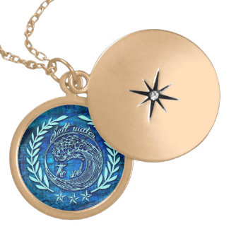 Salt water soothes the soul surf art on blue base. gold plated necklace