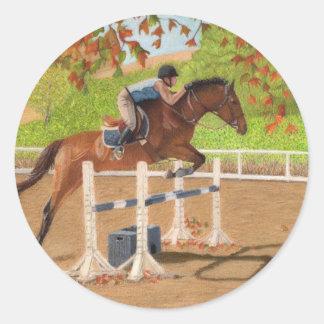 Salto colorido del caballo y del jinete pegatina redonda