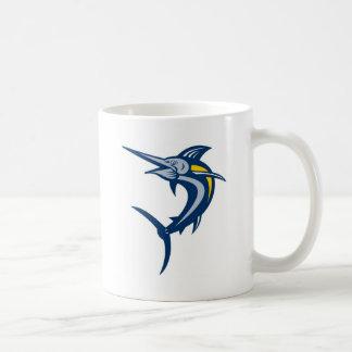 Salto de la aguja azul aislado en blanco taza