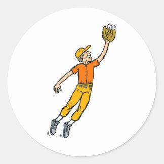 Salto del béisbol para el muchacho de la captura etiquetas redondas