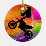 Salto del motocrós en círculos del fuego ornamento de navidad