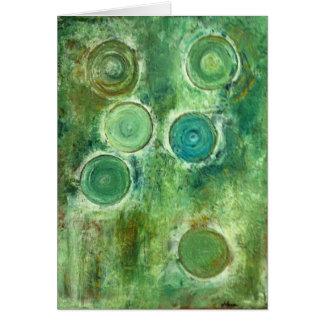 Saludo verde del diseño de los círculos, en blanco tarjeta de felicitación