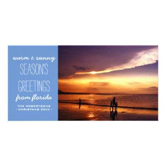 Saludos calientes y soleados del navidad - azul tarjeta fotografica