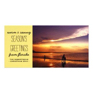 Saludos calientes y soleados del navidad - tarjeta fotografica