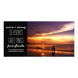 Saludos calientes y soleados del navidad tarjetas fotográficas