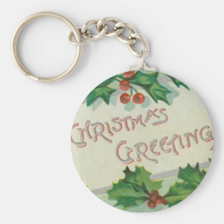 Saludos del navidad con acebo llavero redondo tipo pin