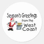 Saludos del navidad de la costa oeste etiquetas redondas