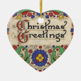 Saludos del navidad del vintage con la frontera de ornato
