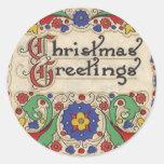 Saludos del navidad del vintage con la frontera de pegatina
