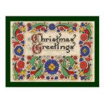 Saludos del navidad del vintage con la frontera de postal