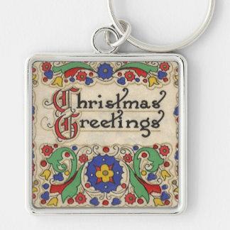 Saludos del navidad del vintage con la frontera llavero cuadrado plateado