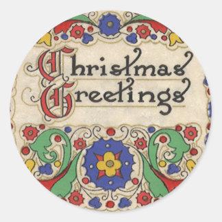 Saludos del navidad del vintage con la frontera pegatina redonda