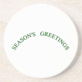 Saludos verdes de las estaciones del navidad posavaso para bebida