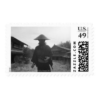 Samurai warrior standing, holding a swoard 3 stamps