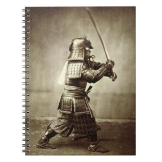 Samurai with raised sword, c.1860 (albumen print) note books