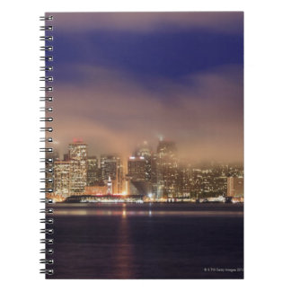 San Francisco skyline in fog at night. Notebook